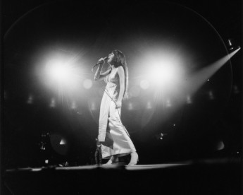 Cher photographed on stage during a performance in New York, 1969.