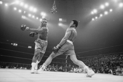 Boxer Muhammad Ali steps away from a punch thrown by boxer Joe Frazier during their heavyweight title fight at Madison Square Garden. Frazier became the undisputed heavyweight champ of the world.