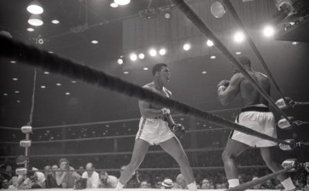 Cassius Clay yells at Sonny Liston during their bout at the Convention Center in Miami Beach, Florida. Cassius Clay won the World Heavyweight Title by RTD in round 6 of 15.