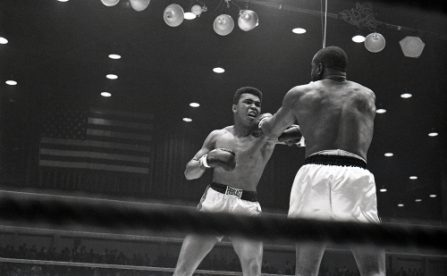 Cassius Clay and Sonny Liston during their bout at the Convention Center in Miami Beach, Florida. Cassius Clay won the World Heavyweight Title by RTD in round 6 of 15.