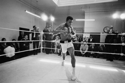 American heavyweight boxer Muhammad Ali throws bare-handed punches in the ring while in training for his fight against Brian London