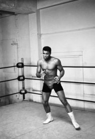 Cassius Clay, between training sets at the Main Street Gym preparing for his bout against Archie Moore in Los Angeles, California.