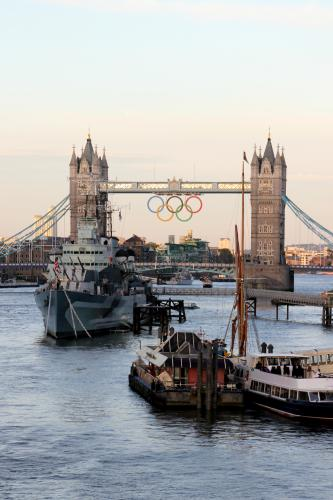Olympic rings hanging from Tower Bridge in London. Photograpged by Barbara Chandler
