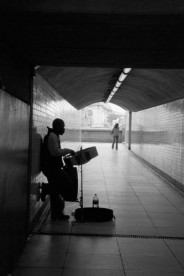 A busker in Westminster subway. Photographed by Barbara Chandler in 2006 Sonic Editions print