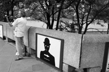 A busker plays the violin near the South Bank in London. Photographed by Barbara Chandler