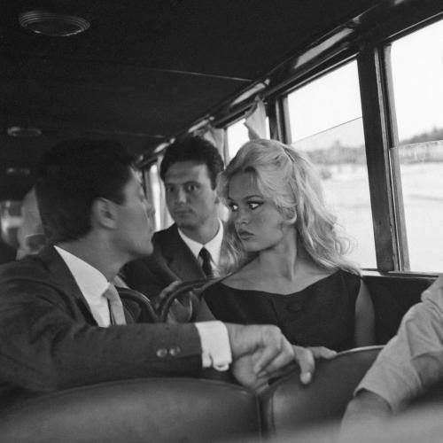 French actress Brigitte Bardot sitting on a vaporetto with Franco Interlenghi and Sasha Distel