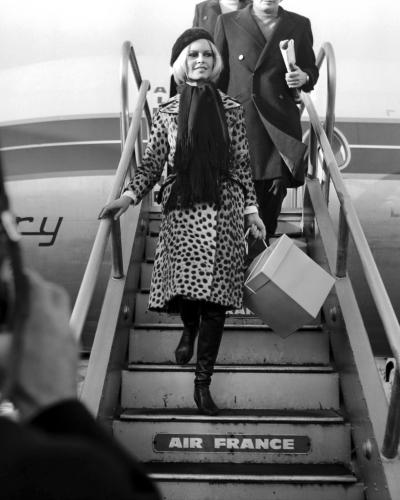 Brigitte Bardot arriving at Heathrow airport with her husband