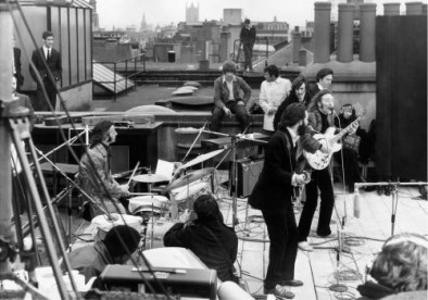 The Beatles performing their last live public concert on the rooftop of the Apple Organization building for the film documentary 'Let It Be'
