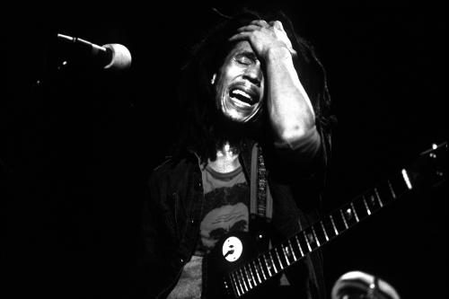 Bob Marley (1945 - 1981) performing on stage in 1975
