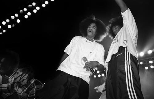 Bone Thugs N Harmony performing on stage.