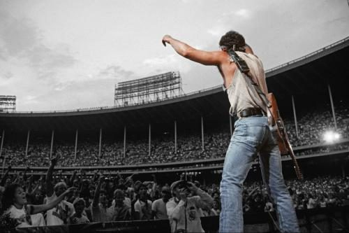Bruce Springsteen performing to the crowd at Cleveland Stadium.