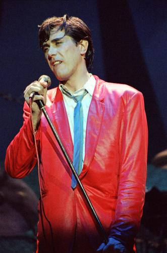 Bryan Ferry on stage with Roxy Music