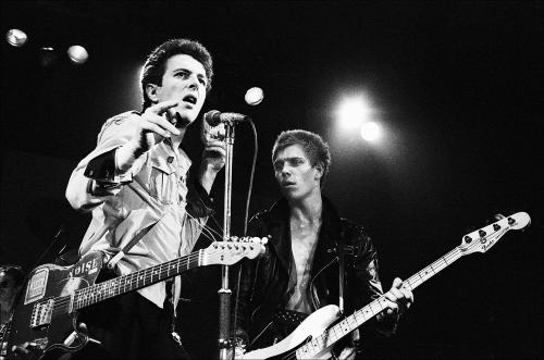 Joe Strummer and Paul Simonon of the Clash on stage at Friars