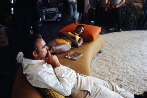 Trina Parks and Sean Connery relax between takes on the set of the James Bond film 'Diamonds Are Forever'. They are filming on location at the Elrod House in Palm Springs