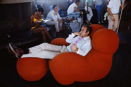 Sean Connery relaxes between takes on the set of the James Bond film 'Diamonds Are Forever'