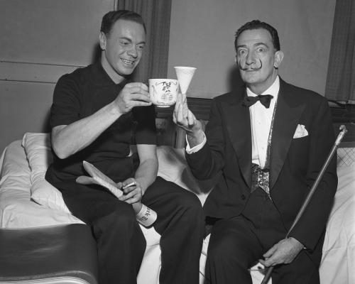 Rock and Roll DJ Alan Freed poses for a portrait with Spanish artist Salvador Dali at the Paramount theatre.