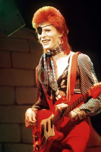 David Bowie performs live on stage as Ziggy Stardust
