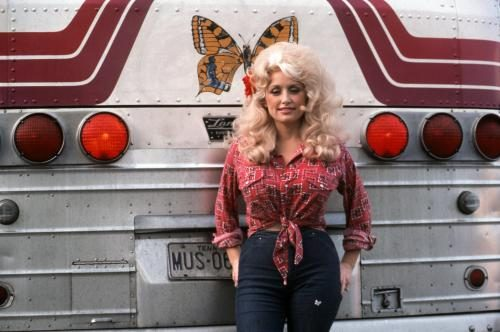 Country Singer Dolly Parton poses for a portrait by her tour bus before performing in Detroit