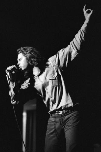 Jim Morrison performs on stage in Detroit
