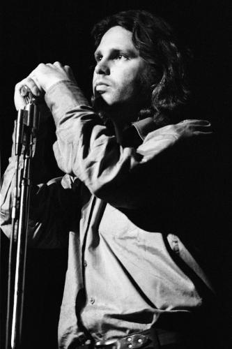 Jim Morrison photographed on stage with the Doors in Detroit.