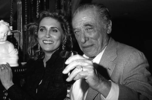 Faye Dunaway and Charles Bukowski attend an event in November 1987 in Los Angeles
