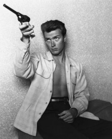 Clint Eastwood checks his gun at home on June 1