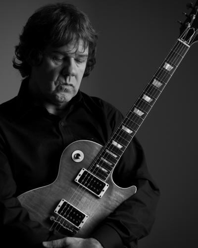 Gary Moore photographed with his Guitar