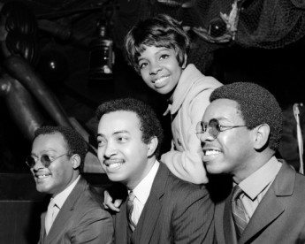 "Gladys Knight & The Pips in London. The group is pictured during a reception at the Mayfair Hotel's Beachcomber bar after their concert at the Saville Theatre.  From left are Edward Patten, William Guest, Gladys Knight and Merald ""Bubba"" Knight."
