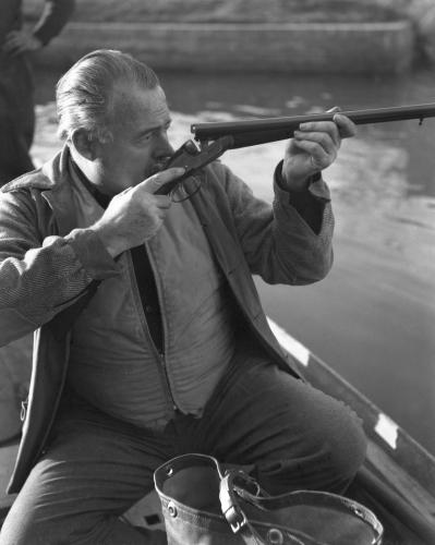 American writer Ernest Hemingway hunting ducks in a pond in Torcello Island