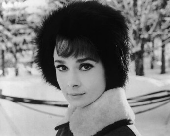 Audrey Hepburn (1929-1993) wearing a fur hat in a scene from 'Charade'