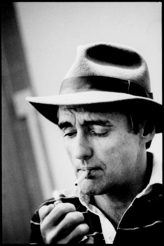 Dennis Hopper lighting a cigarette in London