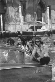 American actor and director Dennis Hopper with fellow actors of 'The Last Movie' taking a water taxi in Venice