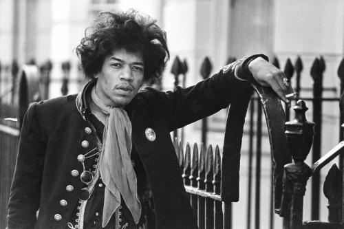Jimi Hendrix poses on a set of railings
