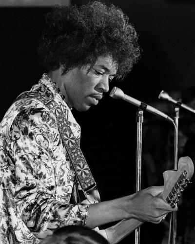 Jimi Hendrix performing on stage in 1967. Photo by Tom Copi.