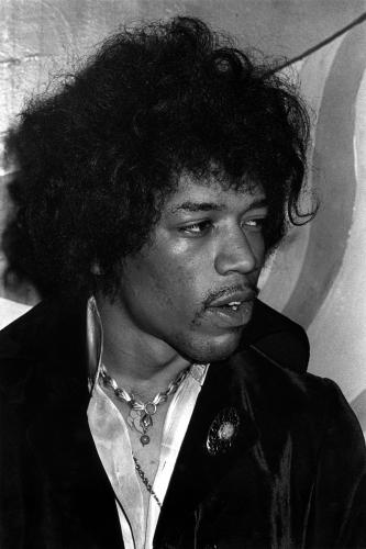 Jimi Hendrix relaxing backstage before performing