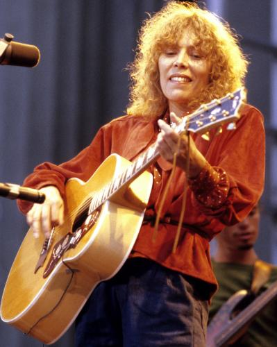 Joni Mitchell photographed performing live on stage in Berkeley.
