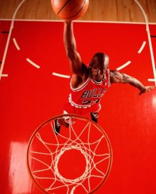 Aerial portrait of Chicago Bulls player Michael Jordan in action.