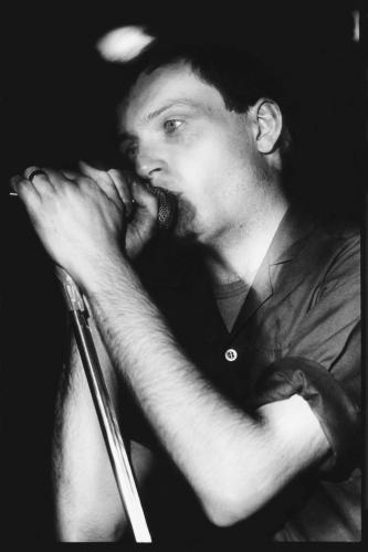 Ian Curtis (1956-1980) photographed on stage with Joy Division at the Moonlight Club in West Hampstead