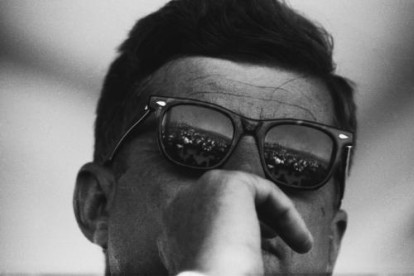 President John F. Kennedy looks thoughtful behind his sunglasses circa the early 1960s.