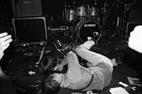 Pete Doherty and Carl Barat of The Libertines roll on the floor at the end of a gig at The Charlotte in Leiciester