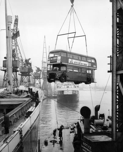 One of two London Routemaster double decker buses being loaded onto the Edelgarde at Millwall Docks