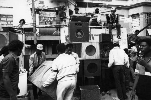 A group of people moving speakers
