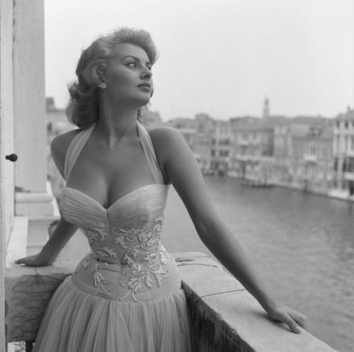 Italian actress Sophia Loren portrayed standing on a terrace on the Canal Grande