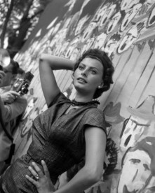 Italian actress Sophia Loren poses against a wall during a photo shoot, Venice.