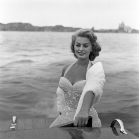 Italian actress Sophia Loren poses on a water taxi, on the Canal Grande, Venice.