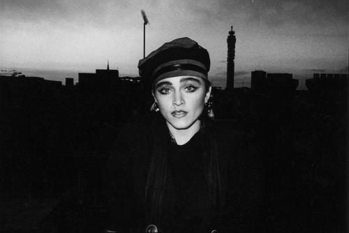 Madonna photographed on the roof of her record company offices in Soho
