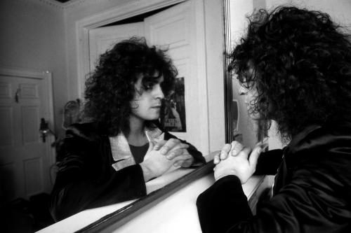 Marc Bolan (1947-1977) contemplates his reflection in a mirror