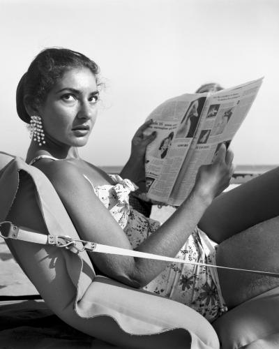 American opera singer Maria 'Callas' Kalogheropoulos lying on an air mattress on Venice Lido beach