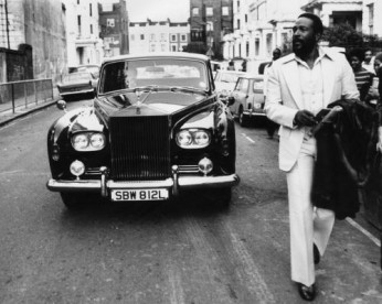 American soul singer Marvin Gaye (1939 - 1984) walking ahead of his Rolls Royce in Notting Hill