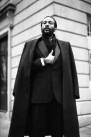 Marvin Gaye looking dapper in a black suit and coat during a photoshoot in Covent Garden, London.